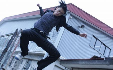 Shun Oguri goes for the flying beatdown in Crows Zero II .